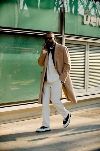 Black Gilet Outfits For Men: A black gilet and white corduroy chinos are totally worth adding to your list of menswear staples. For a truly modern hi/low mix, add black and white canvas work boots to the mix.