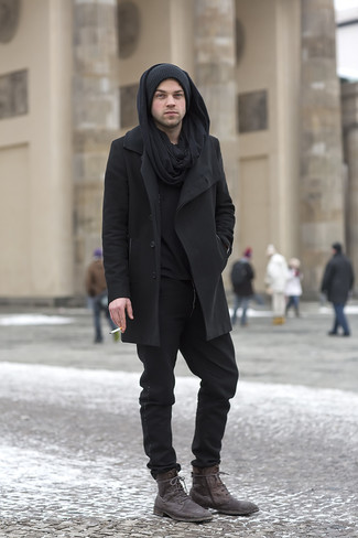 How to wear: black overcoat, black henley sweater, black chinos, dark brown leather casual boots