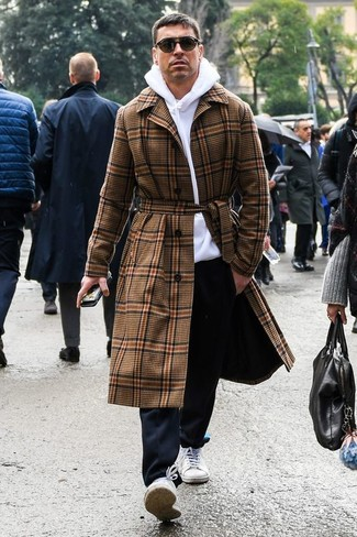 How to wear: brown plaid overcoat, white hoodie, black chinos, white canvas low top sneakers