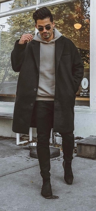 Men's Looks & Outfits: What To Wear In 2020: Wear a black overcoat with black chinos and you'll achieve a sleek and refined menswear style. Complete this look with a pair of black suede chelsea boots to effortlesslly bump up the wow factor of any ensemble.