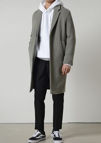 How to Wear a Grey Overcoat: Master the casually classic ensemble in a grey overcoat and black chinos. Feeling adventerous today? Dial down this look by finishing with black and white low top sneakers.