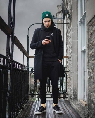 How to Wear a Black Overcoat: Such must-haves as a black overcoat and black chinos are the perfect way to introduce some manly sophistication into your daily routine. Black leather low top sneakers are an effective way to infuse a sense of stylish casualness into this outfit.