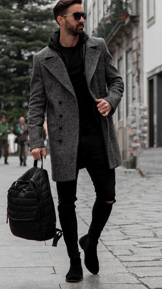 How to Wear a Charcoal Herringbone Overcoat: A charcoal herringbone overcoat and black ripped skinny jeans are the kind of a fail-safe off-duty ensemble that you so terribly need when you have no time to dress up. If you want to effortlesslly perk up this look with one single piece, complement your look with a pair of black suede chelsea boots.