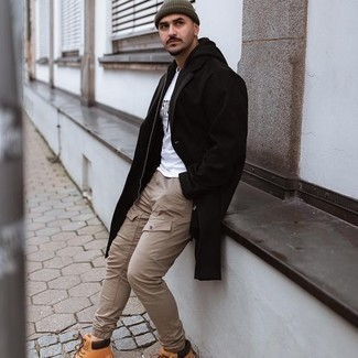 Work Boots Outfits For Men: Inject personality into your day-to-day arsenal with a black overcoat and khaki cargo pants. Why not add work boots to the mix for a more relaxed aesthetic?
