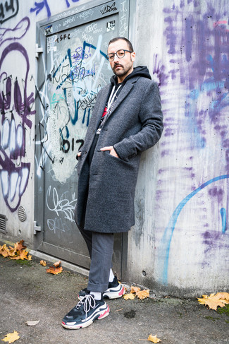 How to Wear a Grey Overcoat: This combo of a grey overcoat and grey wool dress pants couldn't possibly come across as anything other than seriously dapper and classy. Send your outfit in a sportier direction by slipping into a pair of black athletic shoes.
