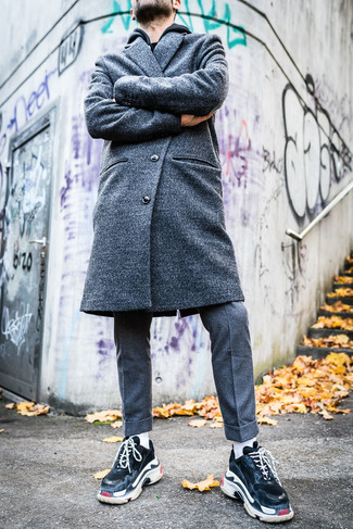 How to Wear a Grey Overcoat: Consider pairing a grey overcoat with grey wool dress pants to look like a true gent with a great deal of class. Unimpressed with this ensemble? Invite black athletic shoes to jazz things up.