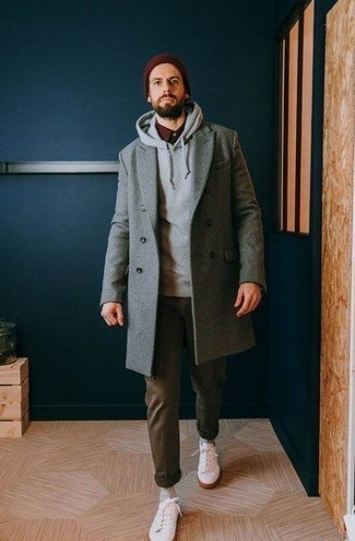 Men's Looks & Outfits: What To Wear In Fall: You'll be surprised at how super easy it is for any man to get dressed like this. Just a grey overcoat paired with olive chinos. You could perhaps get a little creative when it comes to shoes and dress down this look with white low top sneakers. There's no better way to spice up a dreary autumn day than a killer look like this one.