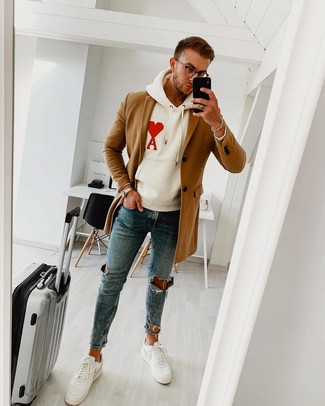 How to Wear White Leather Low Top Sneakers In Chill Weather In a Relaxed Way For Men: A camel overcoat and blue ripped skinny jeans are among those game-changing menswear staples that can revolutionize your wardrobe. A nice pair of white leather low top sneakers pulls this outfit together.