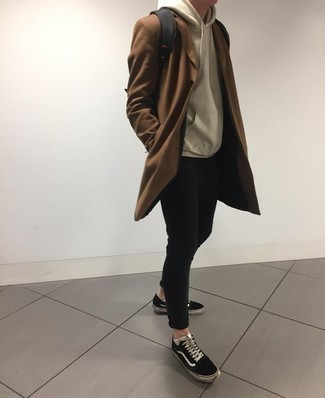 How to Wear Black and White Canvas Low Top Sneakers For Men: A resounding yes to this relaxed combo of a brown overcoat and black skinny jeans! For something more on the off-duty end to finish your outfit, introduce black and white canvas low top sneakers to the mix.
