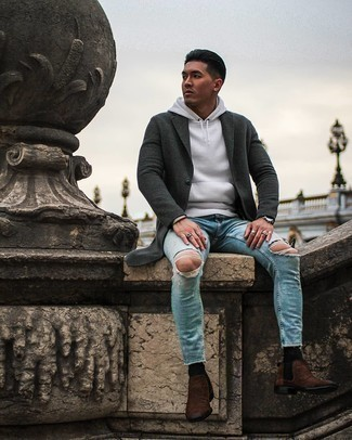 Chelsea Boots Outfits For Men: For relaxed dressing with a contemporary spin, you can dress in a charcoal overcoat and light blue ripped skinny jeans. A pair of chelsea boots adds a sophisticated aesthetic to the getup.