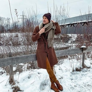 500+ Winter Outfits For Men: This pairing of a brown check overcoat and tobacco jeans comes to rescue when you need to look dapper in a flash. Complete your outfit with a pair of tobacco leather casual boots and ta-da: this getup is complete. As you can see, this getup is dapper and will keep you toasty.