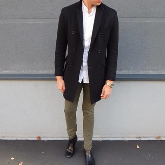 How to wear: black overcoat, white long sleeve shirt, olive chinos, black leather chelsea boots