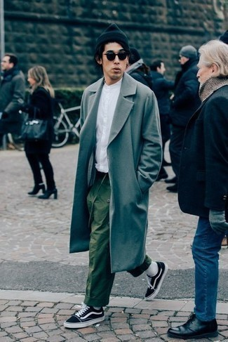 How to Wear a Grey Overcoat: This pairing of a grey overcoat and olive chinos is incredibly sharp and provides a clean and crisp look. If you wish to instantly dress down your look with a pair of shoes, complement this ensemble with black and white canvas low top sneakers.