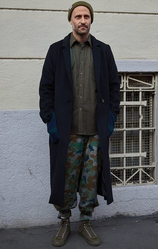How to Wear Camouflage Pants For Men: Inject effortless sophistication into your daily rotation with a navy overcoat and camouflage pants. Olive canvas high top sneakers are the glue that will pull your look together.