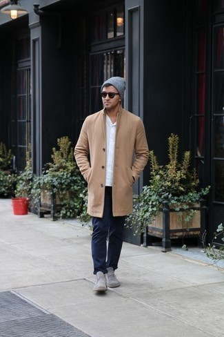 How to Wear Grey Suede Desert Boots: Pair a camel overcoat with navy chinos to be the picture of masculine refinement. Get a little creative on the shoe front and dress down this outfit by finishing with grey suede desert boots.