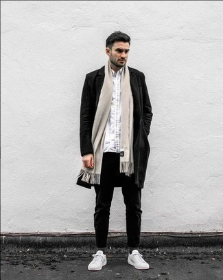 How to Wear a Black Overcoat: A black overcoat and black chinos will add dapper style to your day-to-day arsenal. To add a laid-back touch to this look, opt for white canvas low top sneakers.
