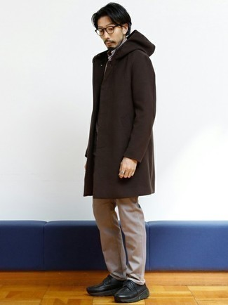 Khaki Chinos Chill Weather Outfits: A dark brown overcoat and khaki chinos make for the perfect base for a great number of casually smart outfits. Black chunky leather derby shoes will instantly smarten up even your most comfortable clothes.