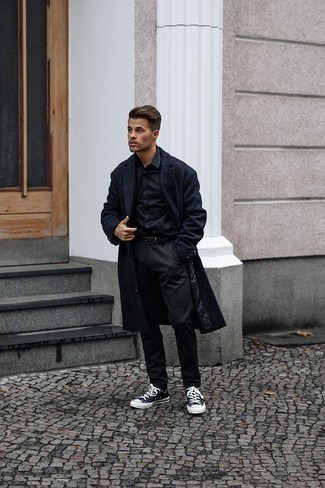 Black Long Sleeve Shirt Outfits For Men: For something more on the cool and laid-back side, make a black long sleeve shirt and black chinos your outfit choice. To give this look a more laid-back touch, why not complement this look with a pair of black and white canvas low top sneakers?