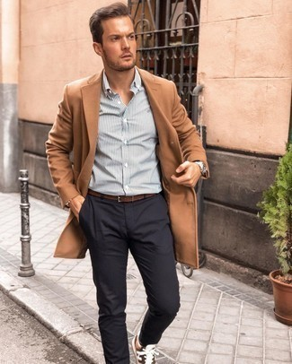 Brown Leather Belt Outfits For Men: You'll be amazed at how easy it is for any man to get dressed like this. Just a camel overcoat and a brown leather belt. Tan athletic shoes will add a new dimension to this outfit.