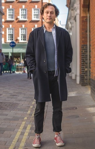 How to Wear Black Jeans For Men: Consider pairing a navy overcoat with black jeans for effortless sophistication with a manly take. To give this look a more casual spin, why not throw a pair of red canvas low top sneakers in the mix?