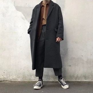 500+ Fall Outfits For Men: For an effortlessly sleek look, marry a charcoal overcoat with charcoal chinos — these pieces play perfectly well together. You could go down a more casual route when it comes to shoes with black and white canvas low top sneakers. This outfit is the definition of perfect for when leaves are falling down and temps are dropping.