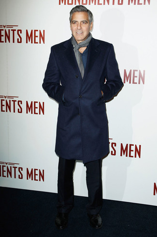 George Clooney wearing Navy Overcoat, Teal Long Sleeve Shirt, Black Dress Pants, Black Leather Derby Shoes