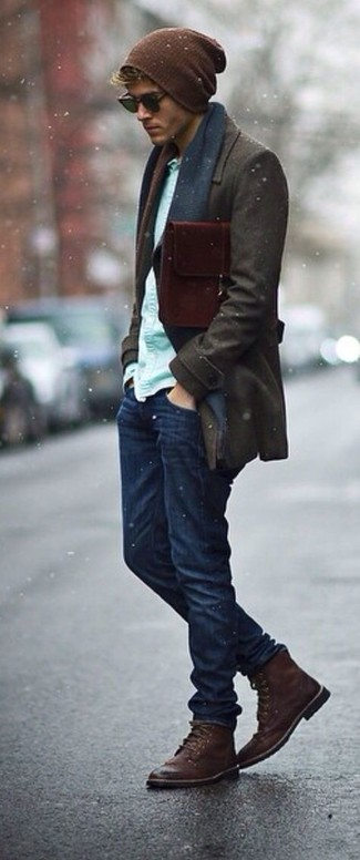 How to wear: dark brown overcoat, mint long sleeve shirt, navy jeans, dark brown leather brogue boots