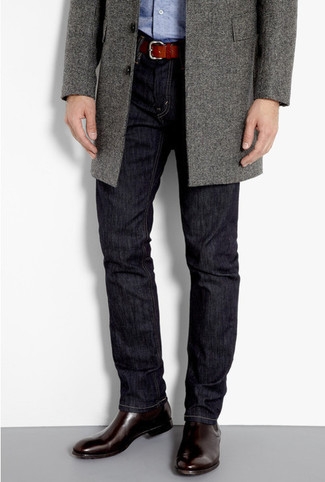 Marry a grey overcoat with navy blue jeans for drinks after work. A pair of dark brown leather chelsea boots will bring a strong and masculine feel to any ensemble.