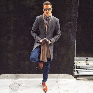 Stand out among other stylish civilians in a grey overcoat and navy jeans. Tap into some David Gandy dapperness and complete your look with brown leather chelsea boots. When spring is in full effect, you'll appreciate how great this look is for in-between weather.
