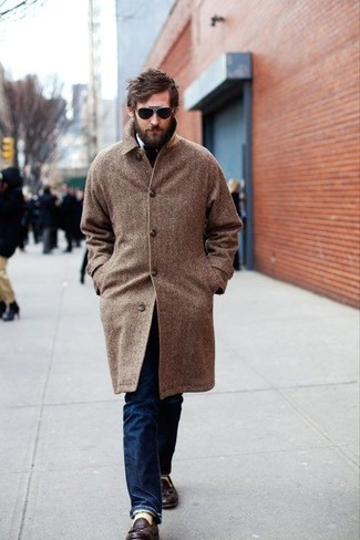 How to Wear a Brown Coat For Men: Go for something effortlessly neat yet timeless with a brown coat and navy jeans. To introduce some extra depth to this ensemble, introduce a pair of dark brown leather tassel loafers to the equation.