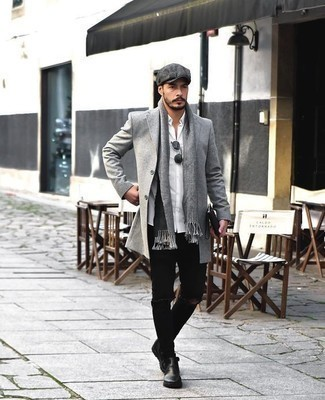 How to Wear Black Jeans For Men: A grey overcoat and black jeans are a nice go-to pairing to have in your closet. Black leather chelsea boots will give an added touch of style to an otherwise everyday look.