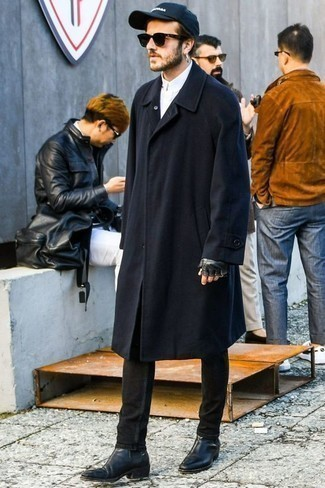 How to Wear an Overcoat: We're loving how this classic and casual pairing of an overcoat and black jeans instantly makes men look dapper. Why not take a more polished approach with shoes and introduce a pair of black leather chelsea boots to the equation?