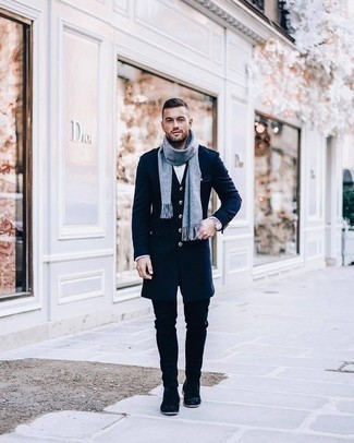How to Wear Black Jeans In Cold Weather For Men: This combination of a navy overcoat and black jeans looks neat and immediately makes any gentleman look cool. Rev up the formality of this outfit a bit by wearing navy suede chelsea boots.