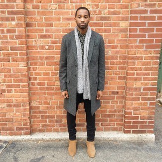 Tan Suede Chelsea Boots with Black Jeans Outfits For Men In Their 30s: This combination of a charcoal herringbone overcoat and black jeans makes for the perfect base for a countless number of effortlessly smart combinations. Smarten up this outfit with the help of a pair of tan suede chelsea boots. As a young man, you probably want to start dressing like an adult man. In this case, outfits like this are ideal as inspiration.