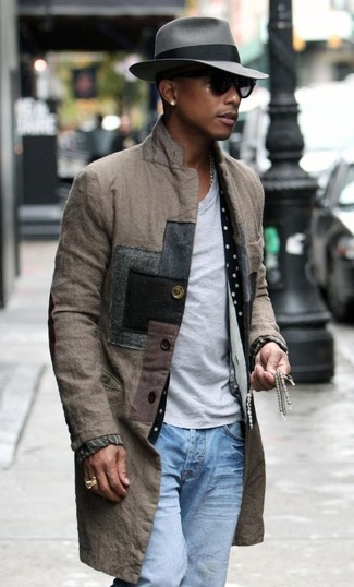 Perfect the smart casual look in a brown overcoat and light blue jeans.