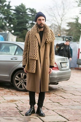 Men's Looks & Outfits: What To Wear In Winter: For a look that's worthy of a modern fashionable gentleman and effortlessly classic, try pairing a camel overcoat with black chinos. Add black leather chelsea boots to completely change up the ensemble. This is one of those winter-friendly outfits that you can totally wear on your venture out when it's below zero outside.