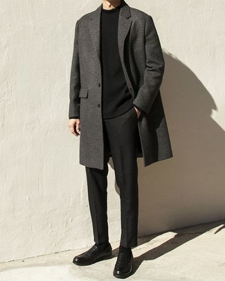Black Leather Loafers Outfits For Men: This pairing of a charcoal overcoat and black chinos is undoubtedly a statement-maker. You could perhaps get a little creative on the shoe front and spruce up this outfit with a pair of black leather loafers.