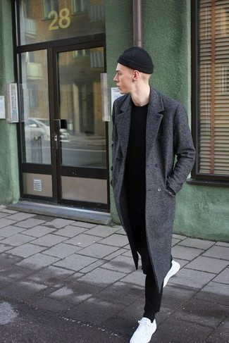 Men's Outfits 2021: A charcoal overcoat and black chinos are totally worth adding to your list of veritable menswear essentials. Add a pair of white canvas low top sneakers to the equation to infuse a touch of stylish casualness into your getup.