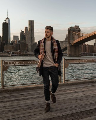 Beige Long Sleeve T-Shirt Outfits For Men: This pairing of a beige long sleeve t-shirt and charcoal jeans is hard proof that a safe casual outfit can still be extra stylish. Breathe an added dose of sophistication into your ensemble by finishing with a pair of dark brown suede desert boots.