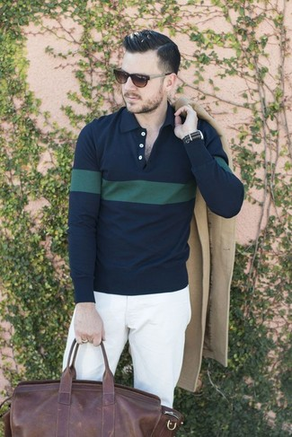 How to wear: beige overcoat, navy and green horizontal striped polo, white chinos, dark brown leather duffle bag