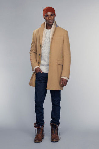How to wear: camel overcoat, beige shawl cardigan, white crew-neck sweater, navy jeans