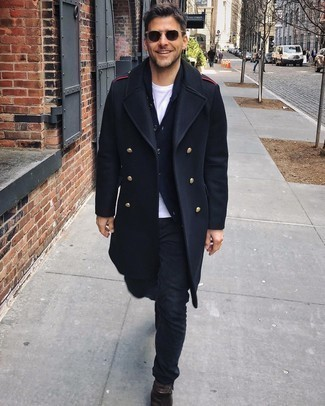 Black Jeans Outfits For Men: This semi-casual pairing of a navy overcoat and black jeans is very easy to put together in no time flat, helping you look amazing and ready for anything without spending too much time searching through your wardrobe. A pair of dark brown suede chelsea boots will bring a more elegant twist to an otherwise too-common look.
