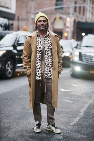 Men's Looks & Outfits: What To Wear In 2020: For a never-failing smart casual option, you can't go wrong with this combo of a camel overcoat and grey vertical striped chinos. Play down the formality of your look by finishing with a pair of white and black print canvas low top sneakers.