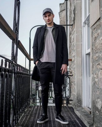 How to Wear a Black Overcoat: This outfit with a black overcoat and black chinos isn't super hard to pull together and leaves room to more creative experimentation. If you want to easily play down your look with a pair of shoes, why not complete your outfit with a pair of black leather low top sneakers?