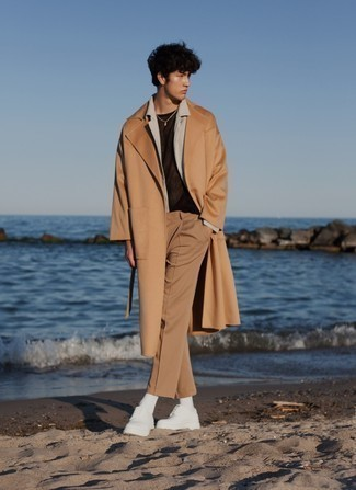 500+ Chill Weather Outfits For Men: Infuse personality into your daily styling repertoire with a camel overcoat and khaki chinos.