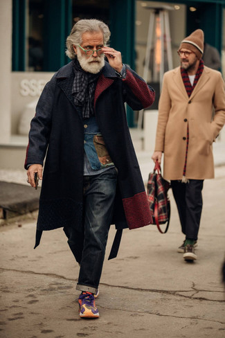 Charcoal Jeans Outfits For Men After 60: Marry a black overcoat with charcoal jeans to exude manly elegance and class. Go the extra mile and change up your ensemble with multi colored athletic shoes. Now that's how you do semi-formal in your sixties.