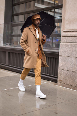 How to Wear a Flat Cap For Men: To create an off-duty ensemble with a city style spin, team a camel overcoat with a flat cap. And if you want to instantly dial down your outfit with shoes, complete your ensemble with a pair of white athletic shoes.