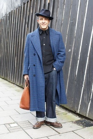 1200+ Outfits For Men After 40: For an effortlessly classic ensemble, opt for a blue check overcoat and navy jeans — these two items work nicely together. Brown leather casual boots will be a welcome complement to your ensemble. Surely a foolproof option when it comes to style tips for gents over 40.