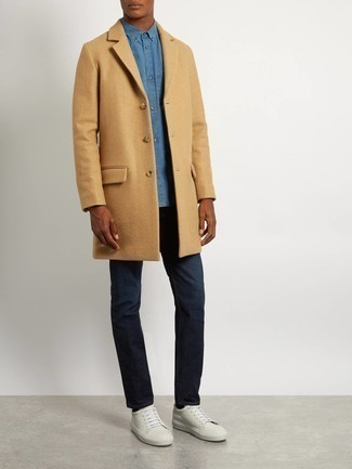 White and Red Leather Low Top Sneakers Outfits For Men: Marrying a camel overcoat and navy jeans is a fail-safe way to inject your closet with some laid-back sophistication. White and red leather low top sneakers are the most effective way to upgrade this ensemble.