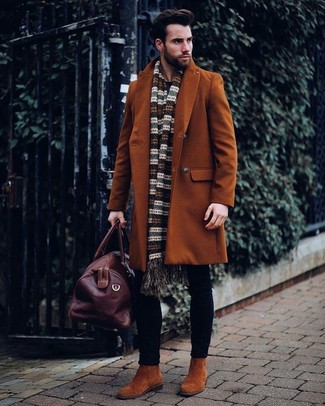 How to Wear a Brown Leather Holdall In Your 30s In Cold Weather Smart Casually For Men: A tobacco overcoat and a brown leather holdall are amazing menswear elements to have in your current casual wardrobe. Complete your ensemble with tobacco suede chelsea boots to switch things up. If you're not sure how to dress appropriately for your age, this combo is a safe option.